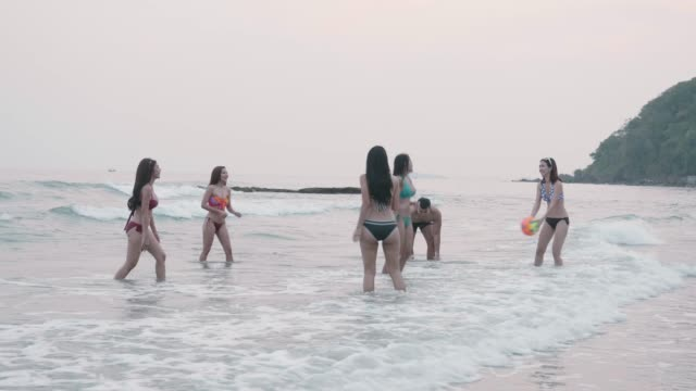friend group playing ball on the beach - beach volleyball stock videos & royalty-free footage