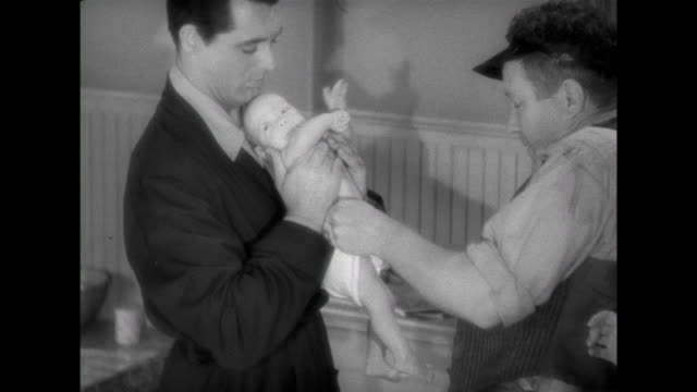 1941 Friend(Edgar Buchanan) instructs parents ( Cary Grant & Irene Dunne) on how to make a diaper