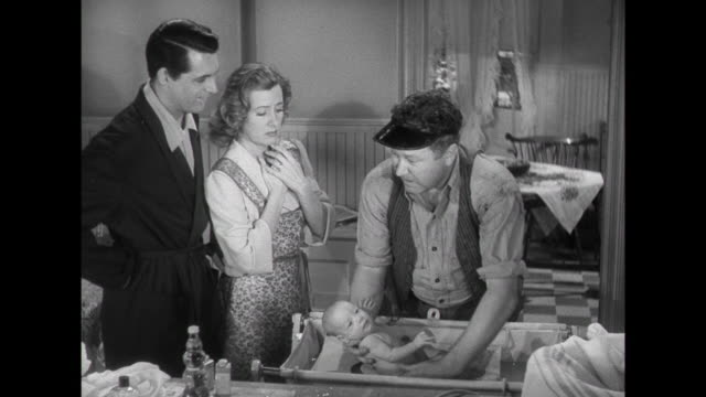 1941 Friend (Edgar Buchannan) teaches father (Cary Grant) and mother (Irene Dunne) how to bathe their new infant
