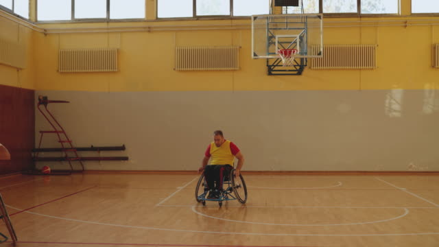 friendly basketball match of sport team in wheelchair - basketball player stock videos & royalty-free footage