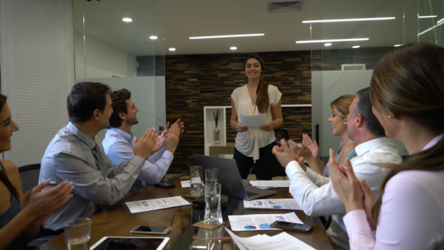 friendly businesswoman thanking her team while they applaud her after a presentation - tax stock videos & royalty-free footage