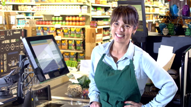 friendly cashier at supermarket checkout - cashier stock videos & royalty-free footage