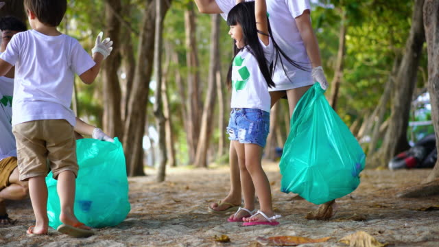 friendly family organized cleaning day to clean park - clean stock videos & royalty-free footage