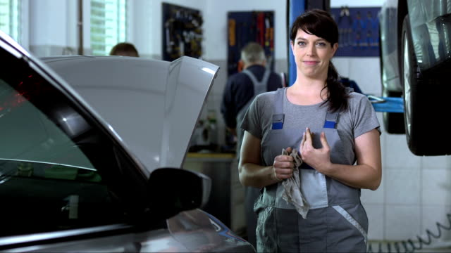 friendly female mechanic - repair garage stock videos & royalty-free footage