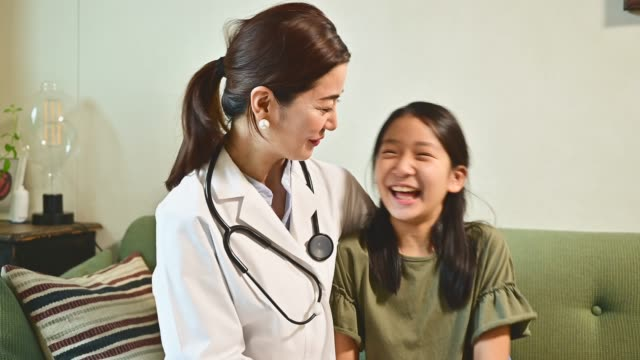 friendly female pediatrician and girl portrait. - trust stock videos & royalty-free footage