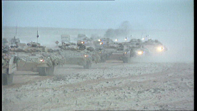analysis of military cover-ups; february 1991 / tx 23.7.91 iraq: ext column of armoured vehicles through desert tank aiming fire as part of... - alliierte stock-videos und b-roll-filmmaterial