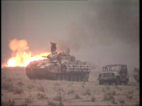 Friendly fire incidents MOD attacked POOL Tank with burning armoured vehicle behind and explosions seen LMS Armoured vehicles in the desert as fire...