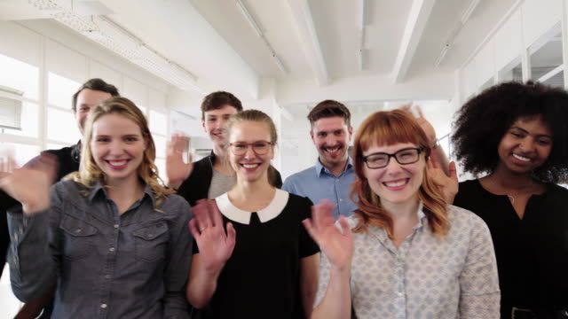 friendly group of employees rejoicing in office - professional occupation stock videos & royalty-free footage