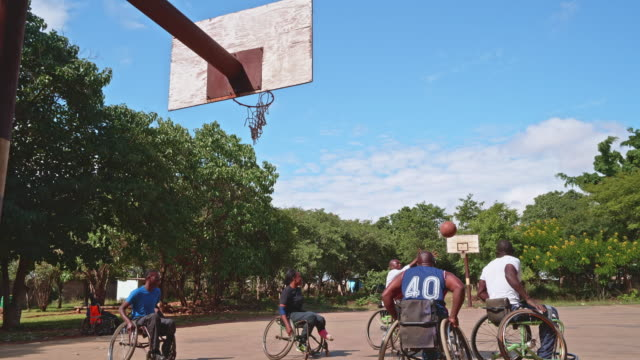 a friendly match among wheelchair basketball players - wheelchair basketball stock videos & royalty-free footage