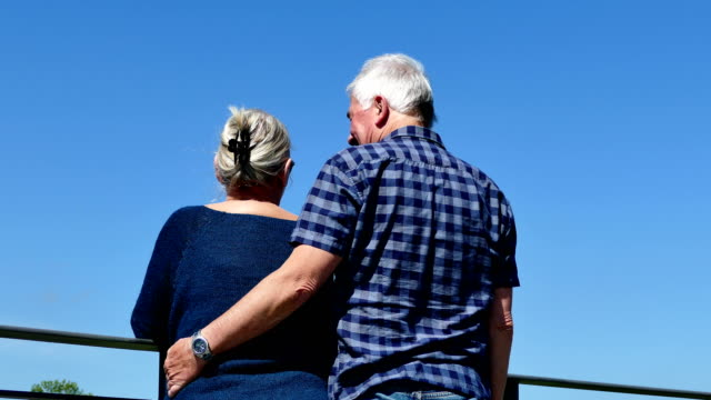 friendly meeting of an older couple - rückansicht stock videos & royalty-free footage