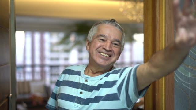 friendly senior saying goodbye - white doorway stock videos & royalty-free footage