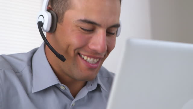 vídeos y material grabado en eventos de stock de friendly telemarketer working at computer - call center latino