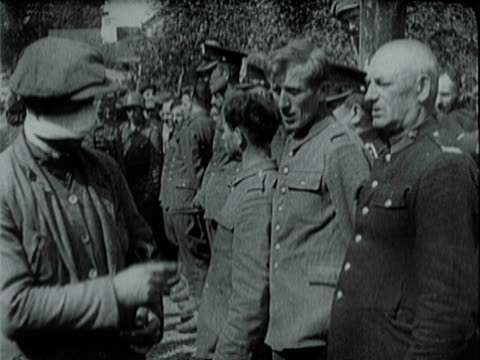friends and admirers of occupying german invaders standing along street waving and offering fascist nazi salute / polish betrayers loyalists and... - poland stock videos & royalty-free footage