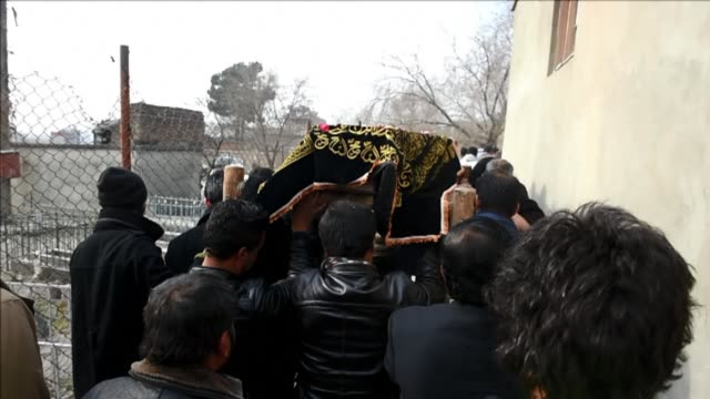 friends and family attend the funeral for an afghan journalist who died in hospital after being injured in a suicide attack on the french cultural... - journalist stock videos & royalty-free footage