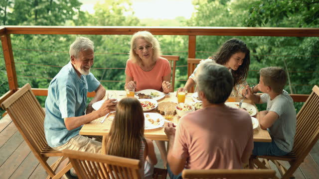 friends and family having a dinner party. - decking stock videos & royalty-free footage