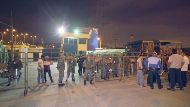 friends and relatives gather outside the penitentiary center of litoral in guayaquil ecuador after a prisoner was killed and several policemen... - litoral stock videos & royalty-free footage