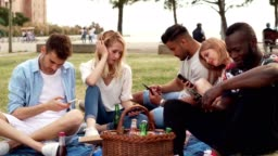 Friends are being bored on picnic