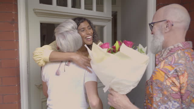 friends are greeted and invited inside - birthday stock videos & royalty-free footage