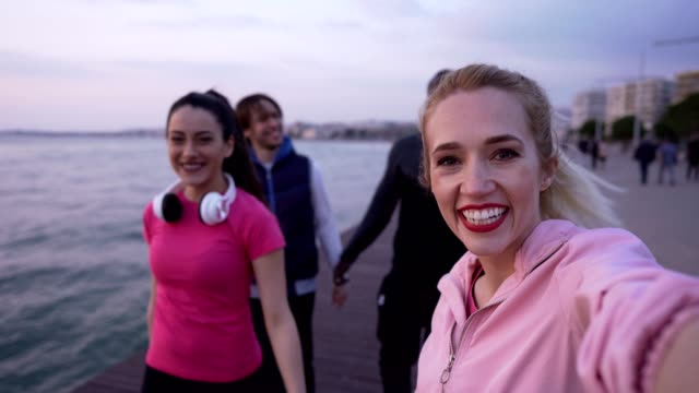 friends are vlogging after jogging - greece stock videos & royalty-free footage