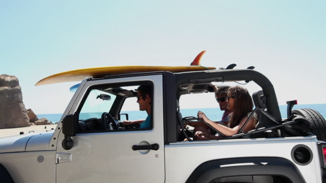 Friends arriving at the beach in SUV
