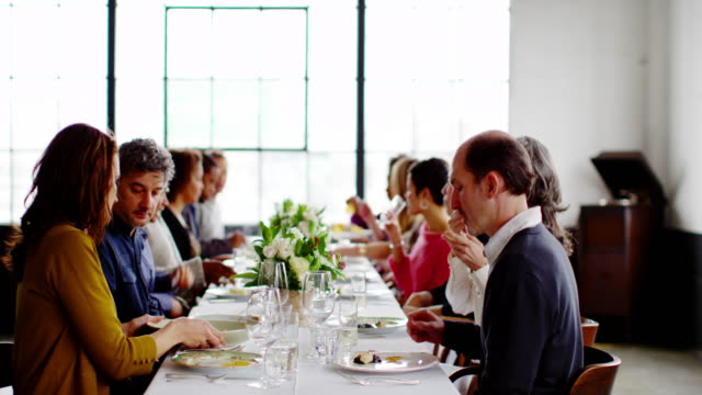 ms friends at dinner party passing food around table - dinner party stock videos & royalty-free footage