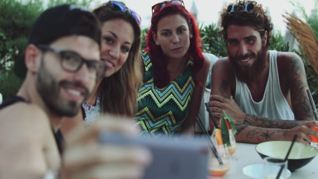 friends at sea: relaxing on the beach at sunset - italy stock videos and b-roll footage