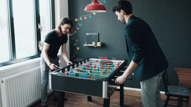 friends at work playing table football - match sport stock videos & royalty-free footage