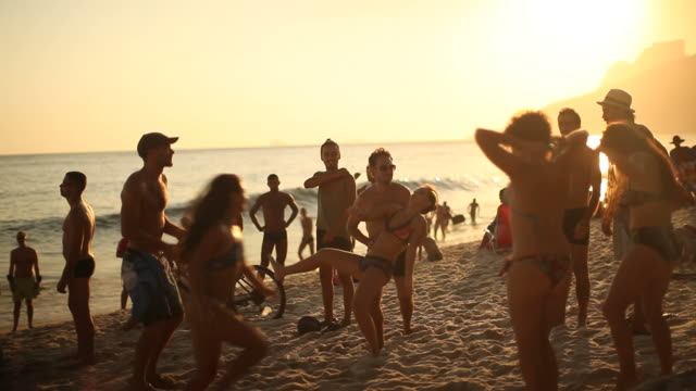 Friends by football on Ipanema Beach at Ipanema Beach on February 01 2012 in Rio de Janeiro Brazil