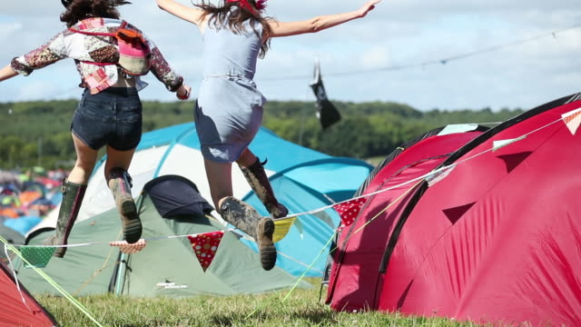 friends camping and having fun at summer festival - music festival stock videos & royalty-free footage