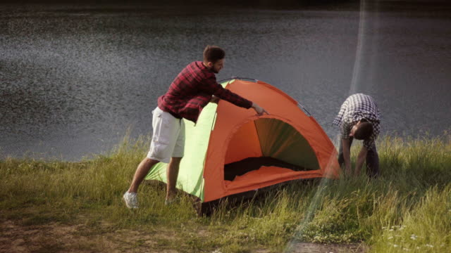 friends camping by the lake - tent stock videos and b-roll footage