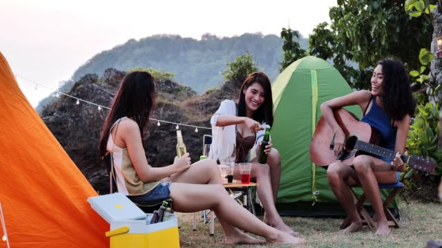 friends camping drinking,camping,summer holidays and vacation concept - nostalgia video stock e b–roll
