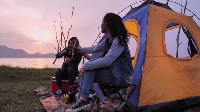 friends camping drinking,camping,summer holidays and vacation concept.camping - camping stock videos & royalty-free footage
