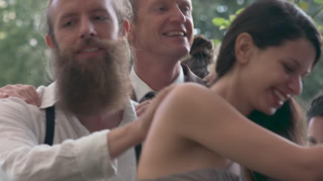 friends celebrating at a wedding party. - wedding stock videos & royalty-free footage