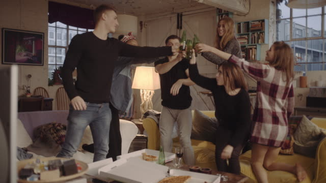 friends celebrating at house party - coffee table stock videos & royalty-free footage