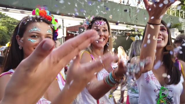 friends celebrating carnaval with confetti in brazil - carnival stock videos & royalty-free footage