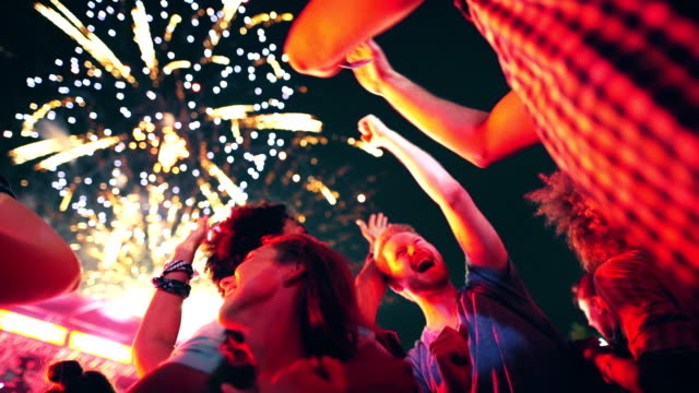 friends celebrating on a night out. - music festival stock videos & royalty-free footage