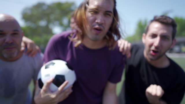 friends celebrating scored goal on soccer field - nose piercing stock videos & royalty-free footage