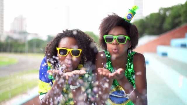 friends celebrating with confetti - latin america stock videos & royalty-free footage