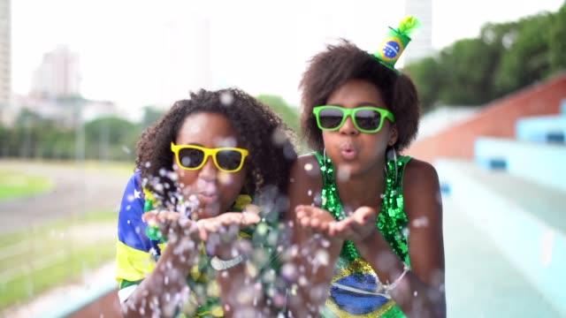 Friends celebrating with confetti