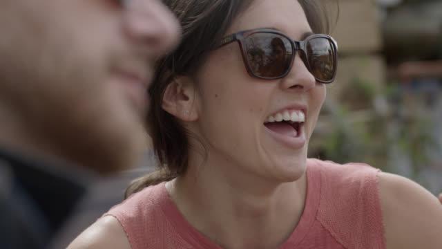 vídeos y material grabado en eventos de stock de friends chat over coffee at outdoor caf_ - terraza