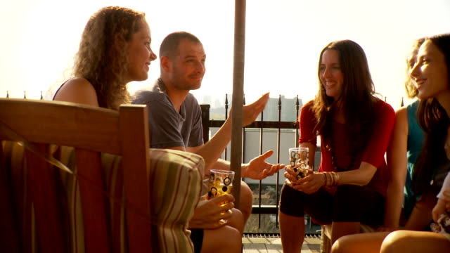 ms friends chatting on balcony / brooklyn, new york - balcony stock videos & royalty-free footage