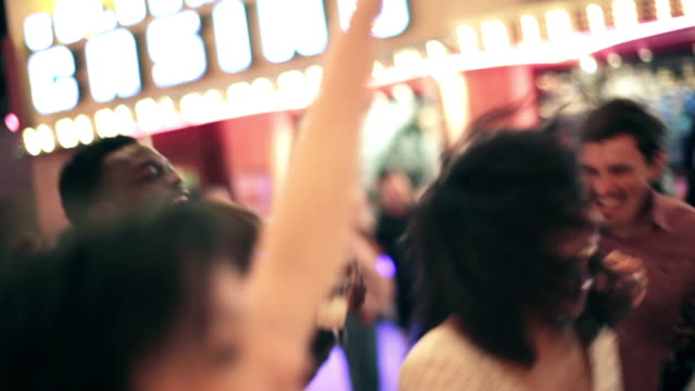 Friends cheer and dance to live music in downtown Las Vegas