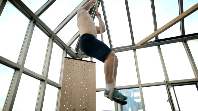 friends climbing thick rope during fitness exercises - rope stock videos & royalty-free footage