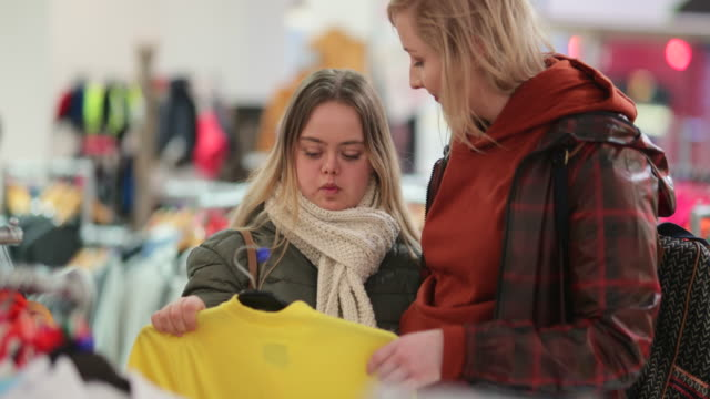 friends clothes shopping - disability stock-videos und b-roll-filmmaterial