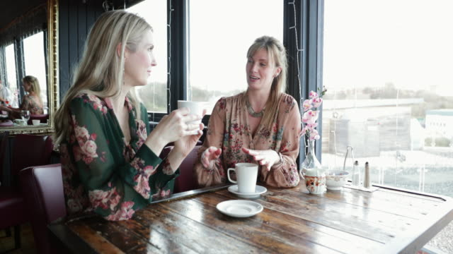 friends coffee date - only mid adult women stock videos & royalty-free footage