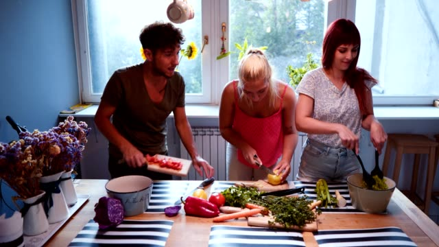friends cooking together - three people stock videos & royalty-free footage