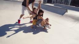 Friends creating a fun video at skateboard park.