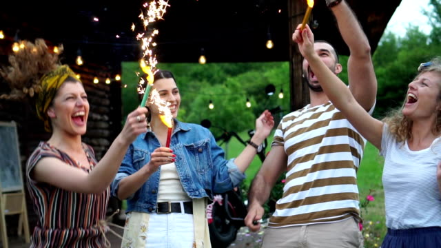 friends dancing around with sparklers - picnic video stock e b–roll