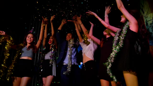 friends dancing in a party and throwing confetti in slow motion - disco dancing stock videos & royalty-free footage