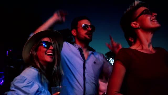 Friends dancing on music festival
